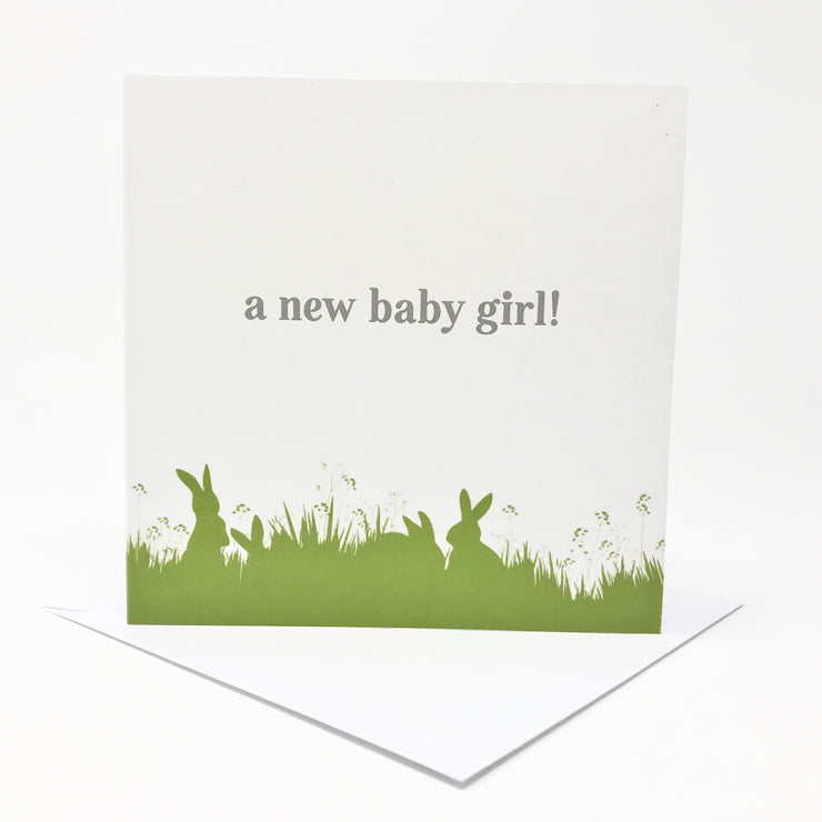 new baby girl card with green bunny illustration at the bottom