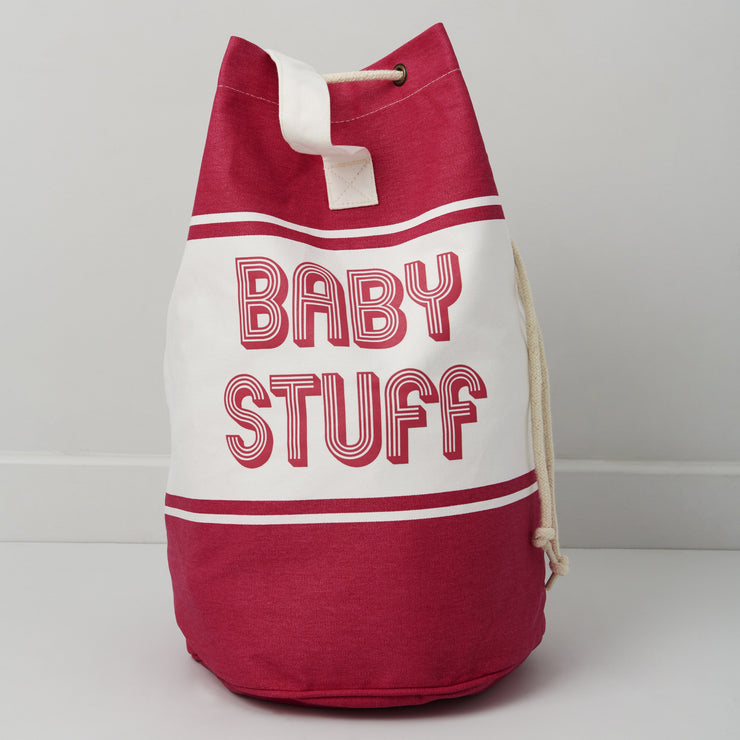 pink baby changing bag with baby stuff printed across the front
