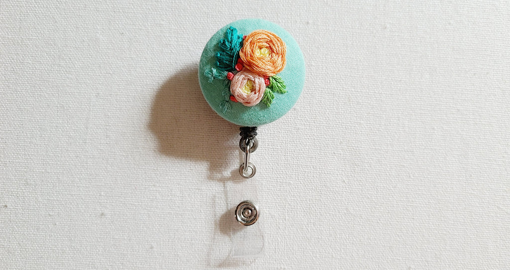 Coral and Peach Roses on Mint Hand Embroidered Retractable Badge Reel