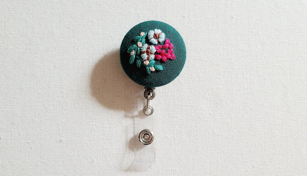 Blue Cotton Flowers and Hot Pink Hydrangea on Dark Green Hand Embroidered Retractable Badge Reel