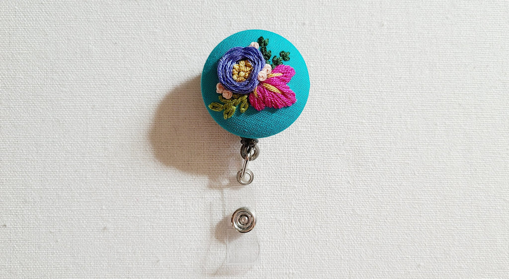 Purple Rose and Magenta Leaves on Turquoise Hand Embroidered Retractable Badge Reel