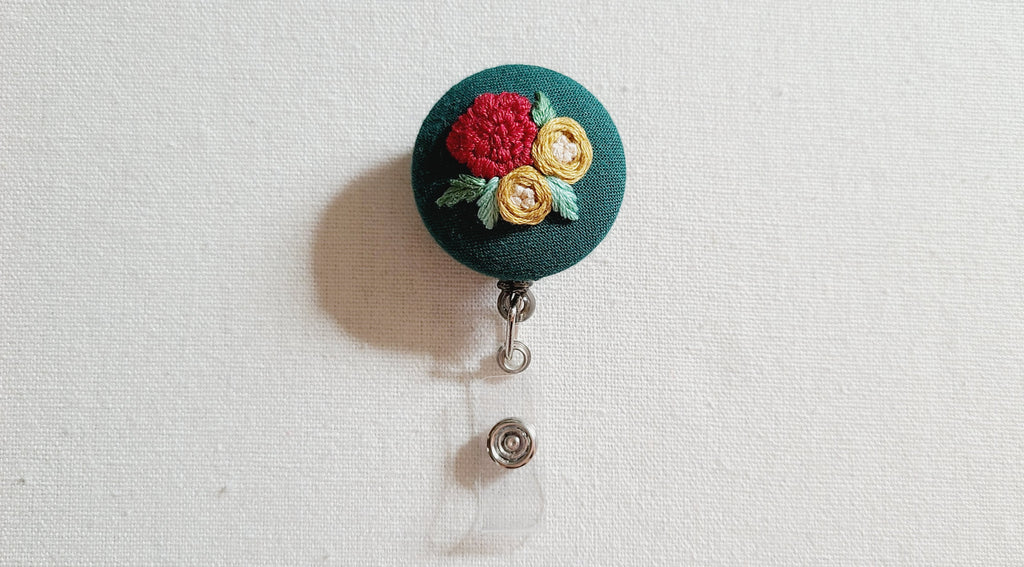 Red Carnation and Yellow Roses on Dark Green Hand Embroidered Retractable Badge Reel