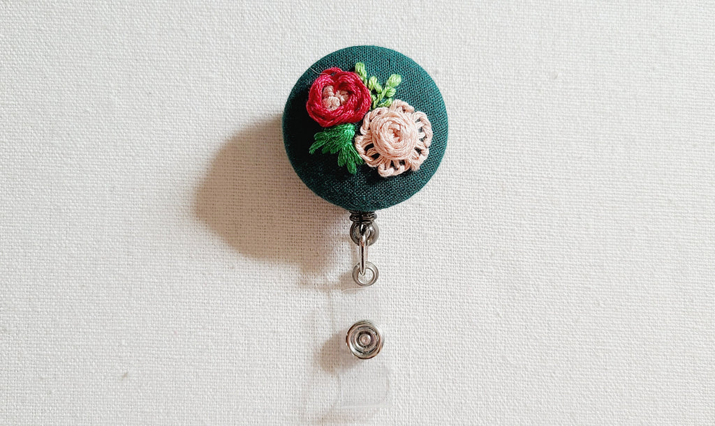 Red and Pink Roses on Dark Green Hand Embroidered Retractable Badge Reel