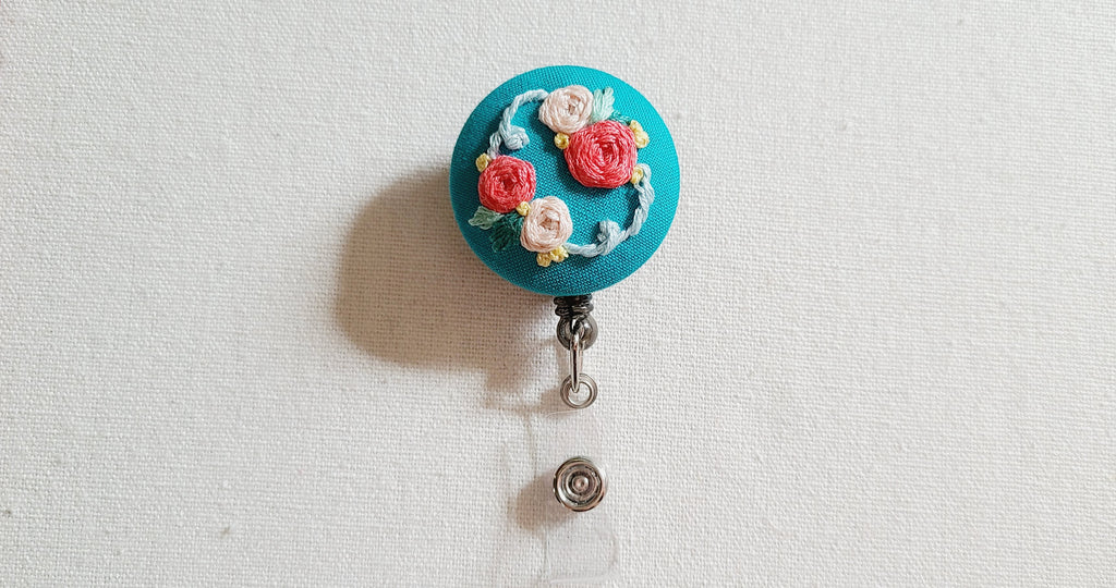 Peach and Coral Roses on Turquoise Hand Embroidered Retractable Badge Reel