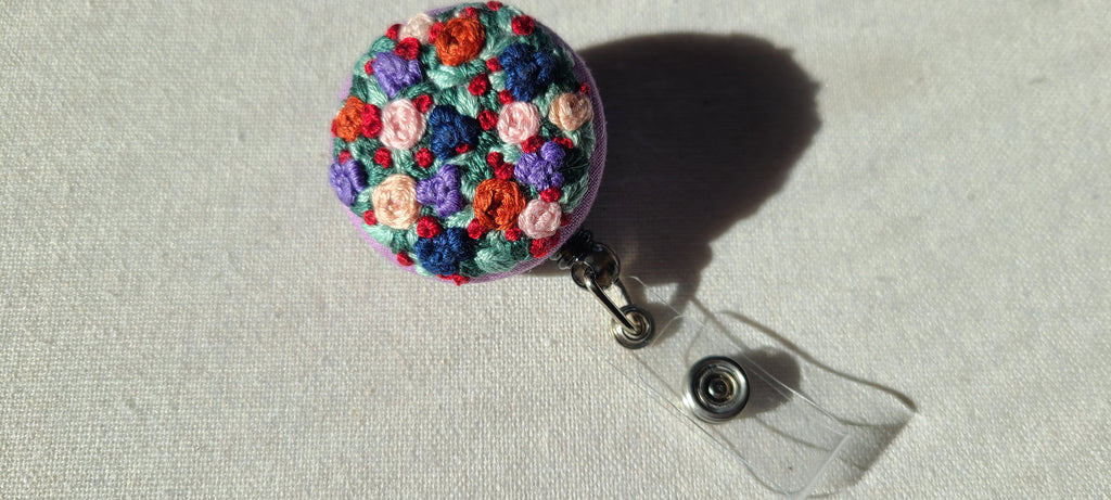 Orange and Blue Garden Patch Hand Embroidered Retractable Badge Reel