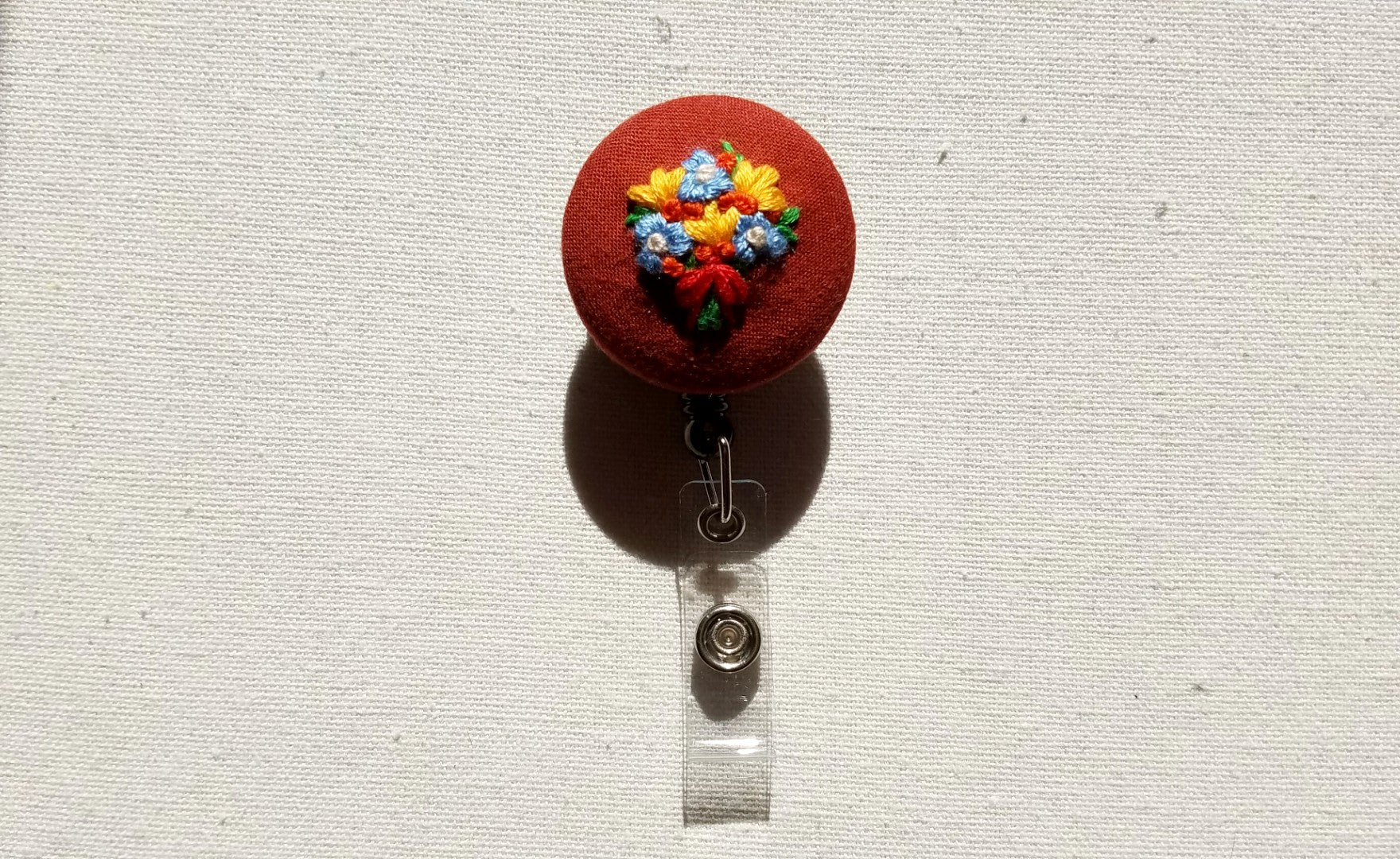 Blue Forget-Me-Nots and Orange Lilies Bouquet on Pumpkin Spice Orange Hand-Embroidered Badge Reel - Little Love Parcels