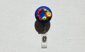 Orange and Yellow Ranunculus Wreath on Royal Blue Hand Embroidered Retractable Badge Reel - Little Love Parcels