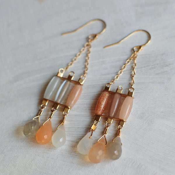 Byzantine style gold chandelier earrings with moonstones in milky white, peach, and smoke.