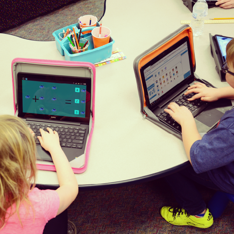 students using laptops at school