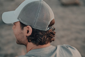 THE NORMAL BRAND LEATHER PATCH TRUCKER HAT
