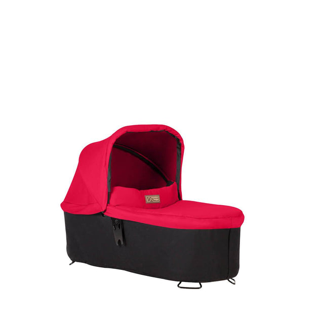 mountain buggy pre-2019 carrycot plus for swift and mini in lie flat mode 3/4 view shown in color berry_berry