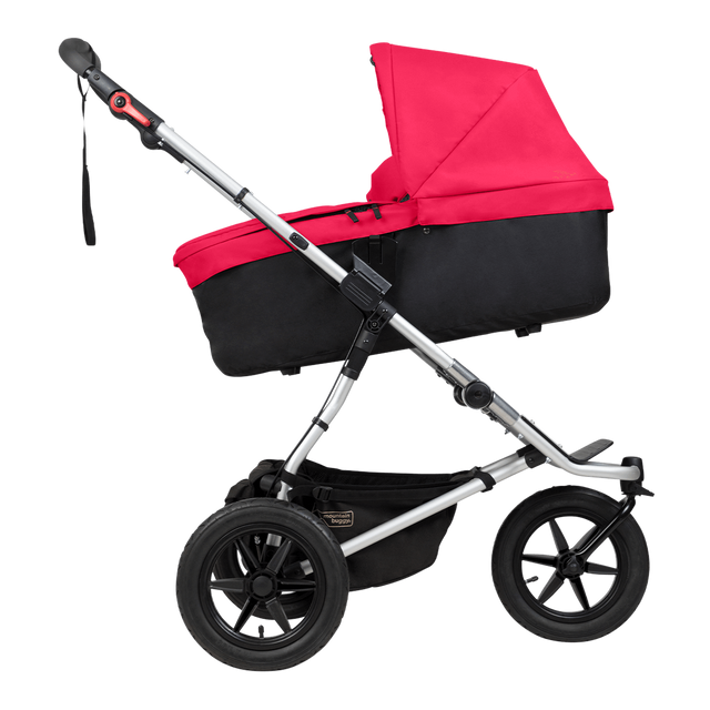 Mountain Buggy carrycot plus on urban jungle buggy in incline mode in colour berry_berry
