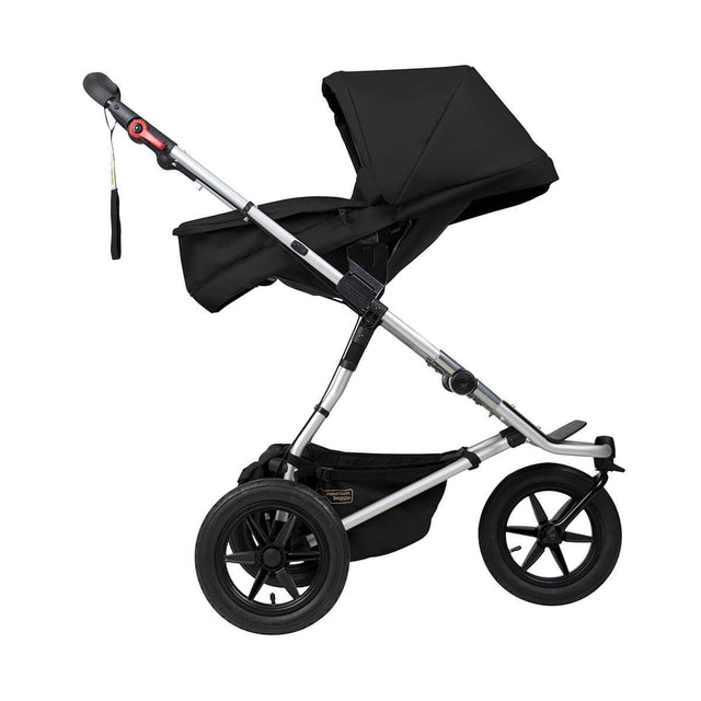 Mountain Buggy carrycot plus on urban jungle buggy in parent facing seat mode in colour black_black