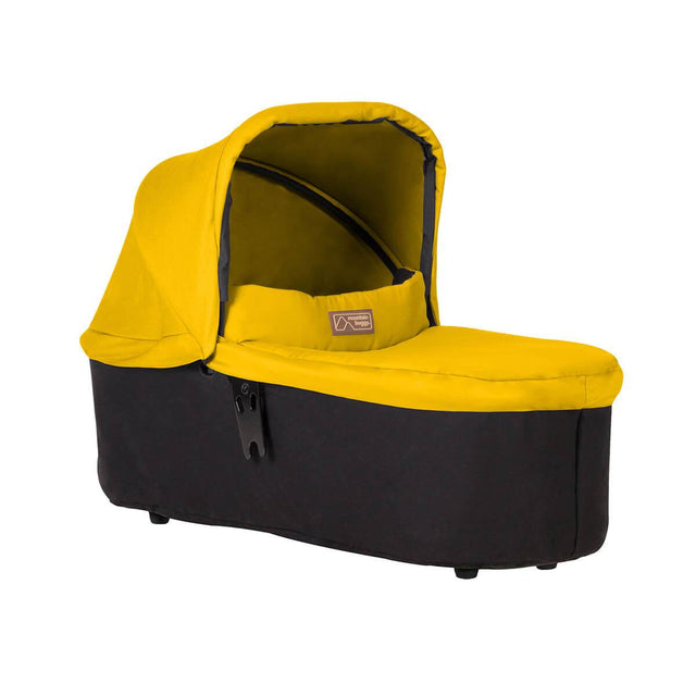 mountain buggy swift and mini carrycot plus in lie flat mode 3/4view shown in color gold_gold