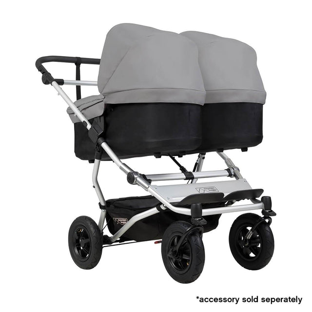 Mountain Buggy duet double buggy fitted with two carrycot plus in parent facing seat position in colour silver_silver