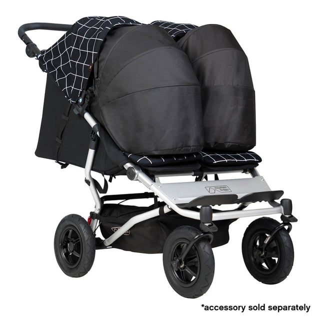 Mountain Buggy duet double buggy fitted with two newborn cocoons in colour grid_grid