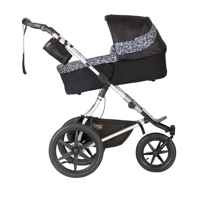 Mountain Buggy carrycot plus on terrain in incline mode in colour graphite_graphite