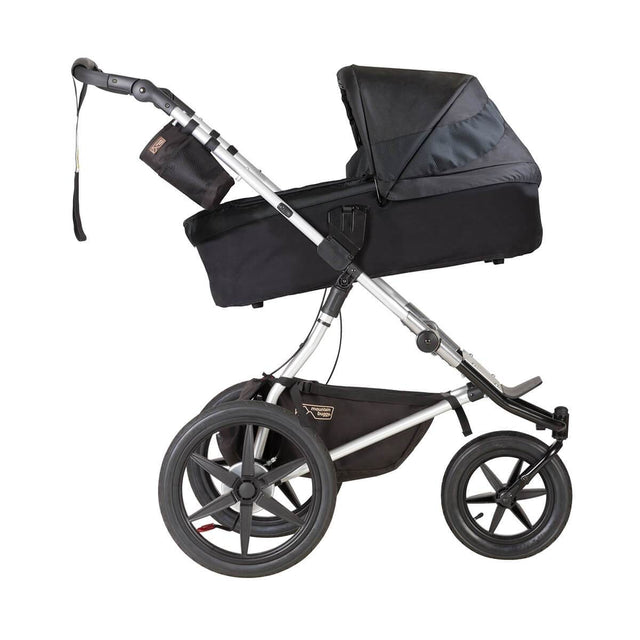 Mountain Buggy carrycot plus on terrain in incline mode in colour onyx_onyx