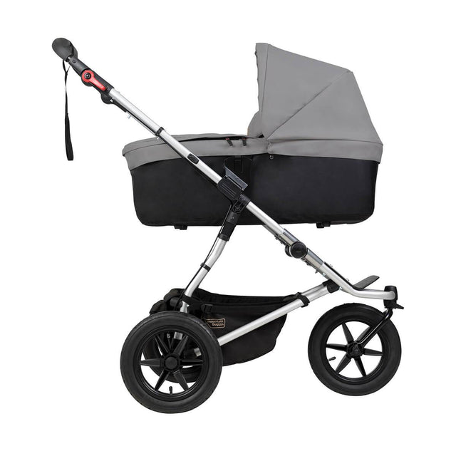 Mountain Buggy carrycot plus on urban jungle in lie flat mode in colour silver_silver