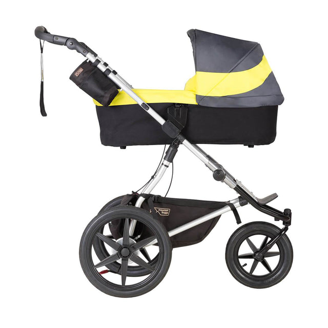 Mountain Buggy carrycot plus on terrain in lie flat mode mode in colour solus_solus