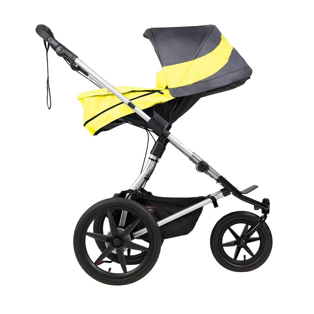 Mountain Buggy carrycot plus on terrain in parent facing mode in colour solus_solus