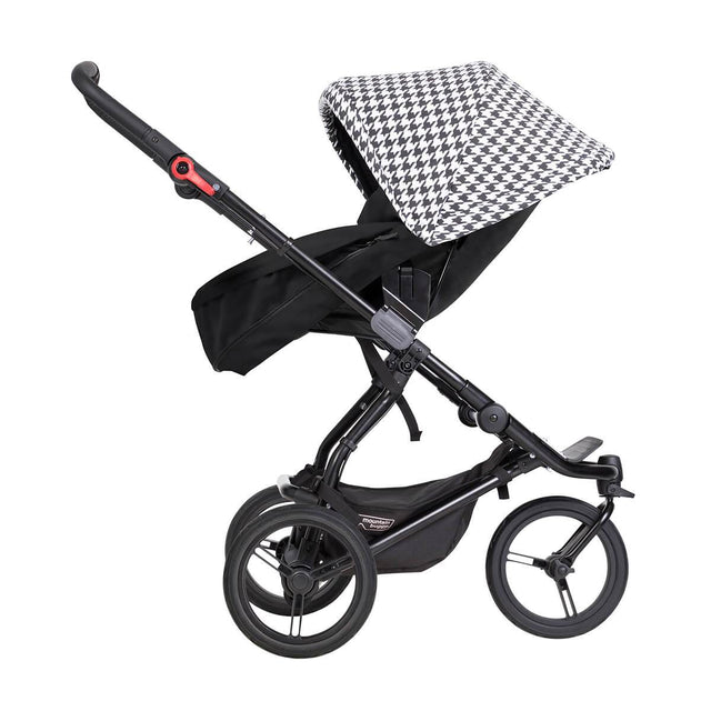 mountain buggy swift luxury compact buggy with carrycot plus in parent facing ode side view in color pepita_pepita
