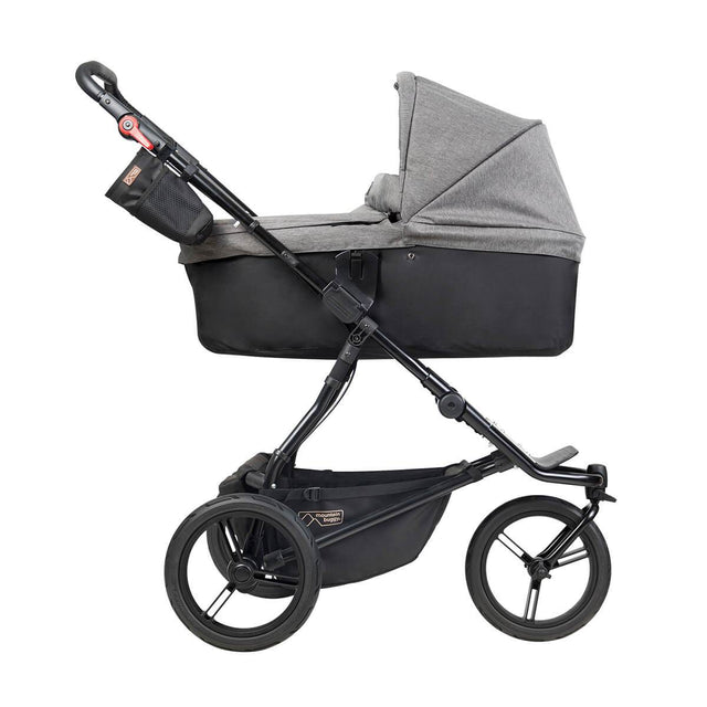 Mountain Buggy carrycot plus on urban jungle luxury in lie flat mode in colour herringbone_herringbone