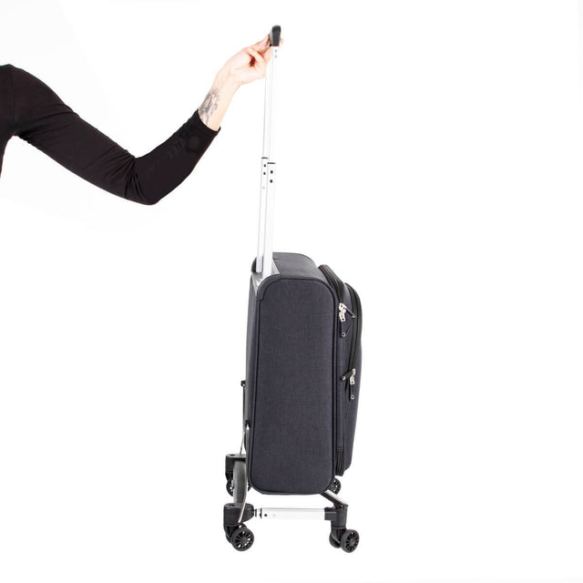 skyrider carry on luggage being held easily by one hand to demonstrate the light weight