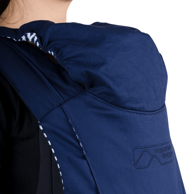 mountain buggy juno baby carrier in nautical blue colour comes with a weather protective hood_nautical