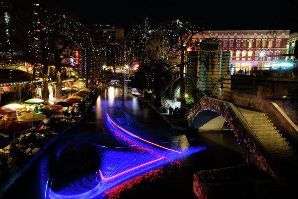 """Christmas Lights and Light Trails by the Riverwalk"" Prints and Products"