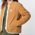 Front model shot of the sherpa jacket in natural/khaki showing the DWR tech fabric unzipped