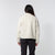 Back model shot of the sherpa jacket in natural/khaki showing the sherpa fleece zipped
