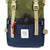 Front Detail Shot of the Topo Designs Rover Pack Classic in Olive/Navy showing front zipper pocket.