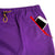 Detail shot of Topo Designs Women's Sport Skirt in Purple showing phone in front zipper pockets.