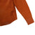 Detail shot of Topo Designs Men's Dirt Shirt in Brick orange showing sleeve cuff.