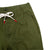 Detail shot of Topo Designs Men's Dirt Pants in Olive green showing drawstring waistband and hand pocket.