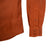 Detail shot of Topo Designs Women's Dirt Shirt in Brick orange showing buttons on sleeve cuff.