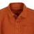 Detail shot of Topo Designs Men's Dirt Shirt in Brick orange showing collar, buttons, and chest pocket.