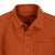 Detail shot of Topo Designs Women's Dirt Shirt in Brick orange showing collar, buttons, and chest pocket.