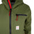 Front detail shot of Topo Designs women's puffer hoodie in olive green showing chest zipper pocket and logo patch.