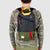 Back model shot of Topo Designs x Alternative Trip Pack in olive/black showing backpack size