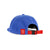 3/4 back view of Topo Designs Fleece Cap in blue showing red logo patch and red webbing strap closure.