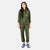 Front model shot of the Topo Designs Women's Coverall jumpsuit in Olive green