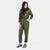 Front model shot of the Topo Designs Women's Coverall jumpsuit in Olive green showing hand pockets.