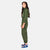 Side model shot of the Topo Designs Women's Coverall jumpsuit in Olive green