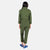Back model shot of the Topo Designs Women's Coverall jumpsuit in Olive green