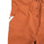 Detail shot of the Topo Designs Women's Coverall in Brick showing front hand pockets