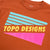 Detail shot of the Men's Long Sleeve Team Tee in clay orange showing Topo Designs chest graphic