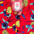 Detail shot of Topo Designs Men's Tour Shirt - Floral in red showing floral print and inside label.
