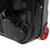 Detail shot of Topo Designs Travel Bag Roller 35L Premium carry-on suitcase in Premium Black showing backpack strap attachment points and red wheels.